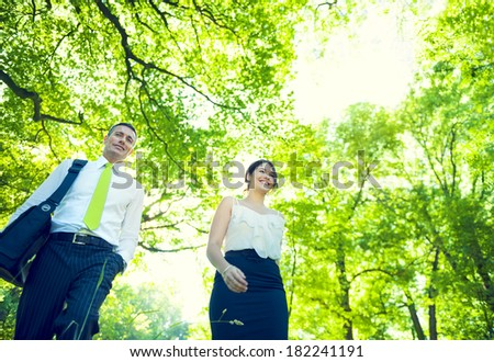 Green Business People in Forest - stock photo
