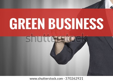Green Business word on virtual screen touch by business man at red tab - stock photo