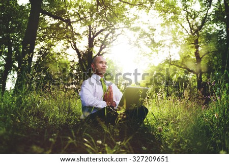 Green Businessman Meditation Technology Peaceful Concept - stock photo