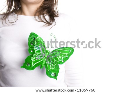 green butterfly standing on young woman chest - stock photo