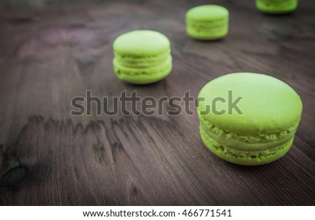 green cake macaron on wood background, maccarone sweet and colorful dessert
