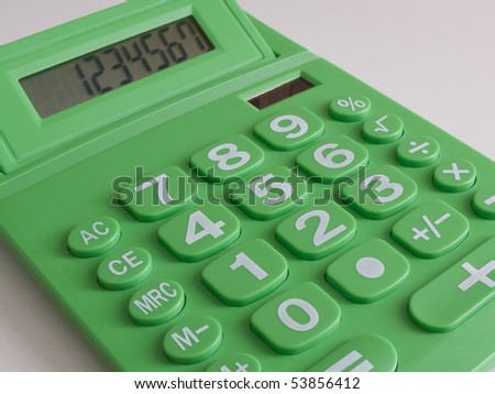 Green calculator which runs on solar power - stock photo