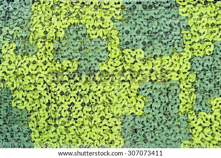 Green camouflage pattern. Camo netting background - stock photo