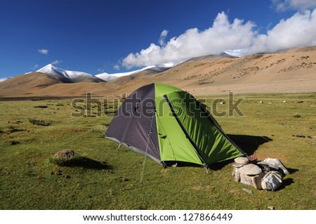 Green Camping tent in high mountain - stock photo