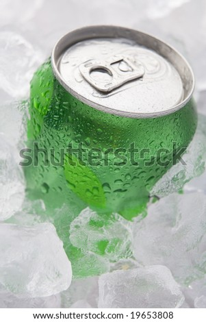 Green Can Of Fizzy Soft Drink Set In Ice - stock photo