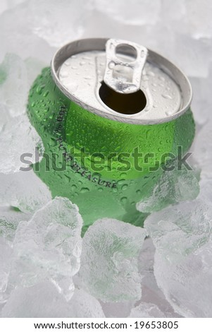 Green Can Of Fizzy Soft Drink Set In Ice With The Ring Pulled - stock photo