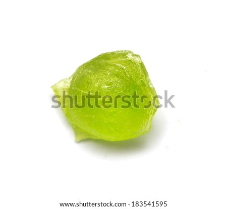 green candy on a white background. macro