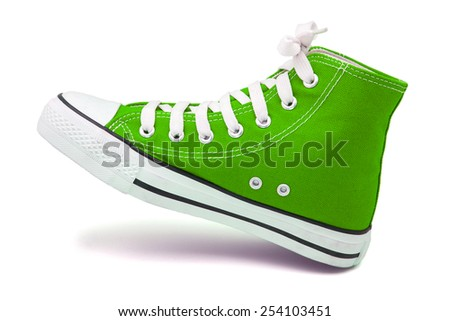 green canvas sneakers isolated on white - stock photo