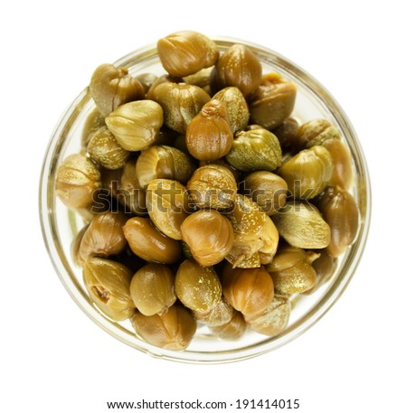 green capers in a glass bowl isolated on white background - stock photo