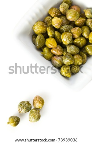 green capers on white background - stock photo