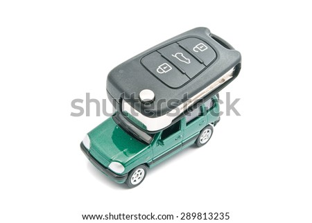 Green car and car keys on white background - stock photo