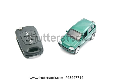 Green car and car keys with alarm on white - stock photo