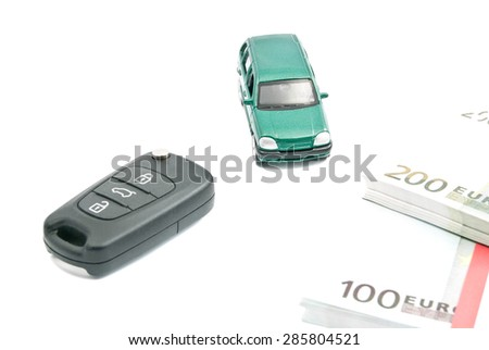 Green car, car keys and euro notes on white - stock photo