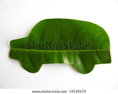 Green car cut from leaf. - stock photo