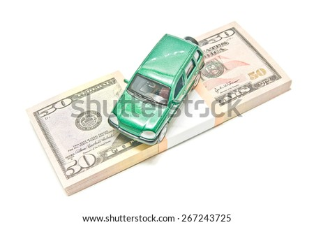 green car on dollar notes on white