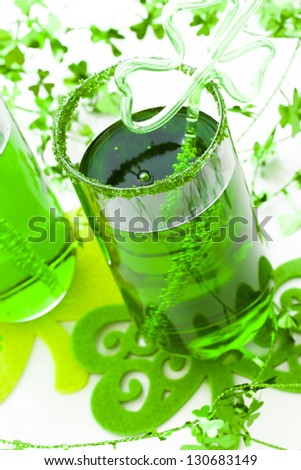 Green carbonated drink with fancy straw for St Patrics day. - stock photo