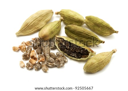 Green cardamom on a white background - stock photo