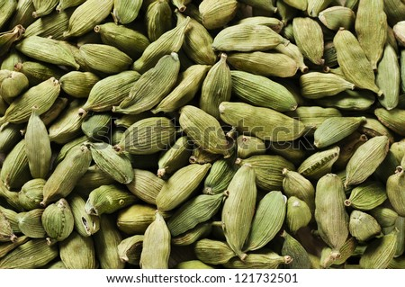 Green Cardamom Pods closeup as the background texture - stock photo
