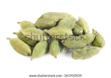 green cardamom pods on white background - stock photo
