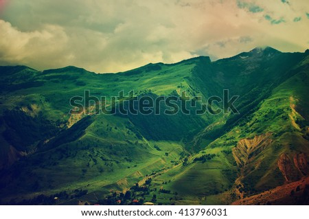 Green caucasus  mountain landscape in Georgia, natural travel vintage hipster vacation background - stock photo