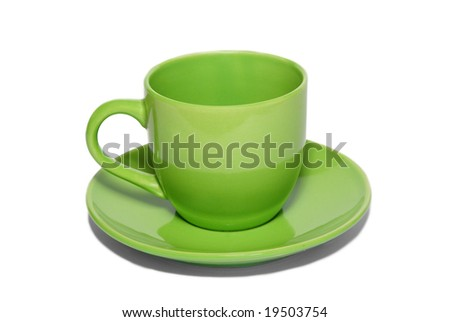 Green ceramic cup and saucer isolated on white.