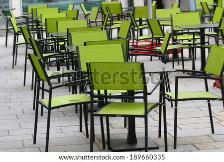 Green chairs and tables a bar with beer garden