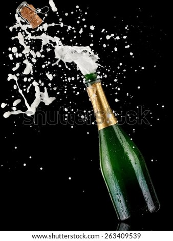 Green champagne bottle splash pop - stock photo