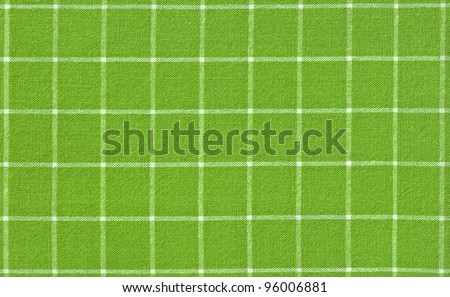 Green checked fabric background - stock photo