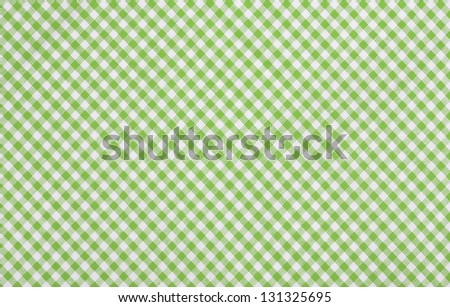 green checkered fabric closeup , tablecloth texture - stock photo