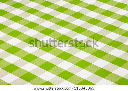 green checkered tablecloth - stock photo