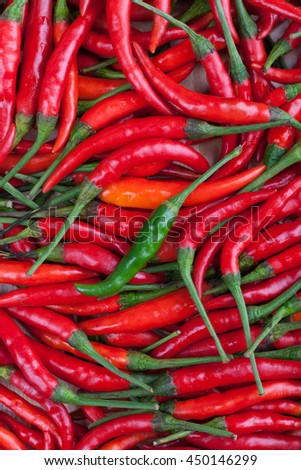 green chilli on red chili or chilli cayenne pepper - stock photo