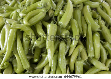 Green chilli peppers closeup