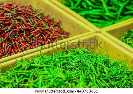 green chilli, red chilli, green and red chilli. Chillies in basket on the market in Thailand. - stock photo