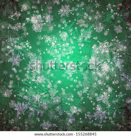 Green christmas background with white snow flakes - stock photo
