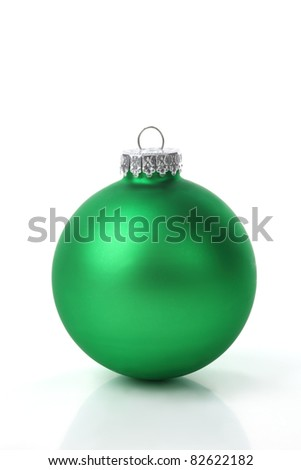 Green christmas ball on white background. - stock photo