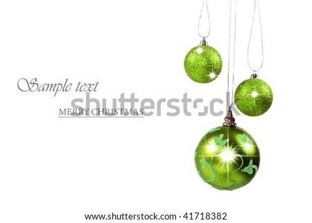 Green christmas baubles against white background with space for text