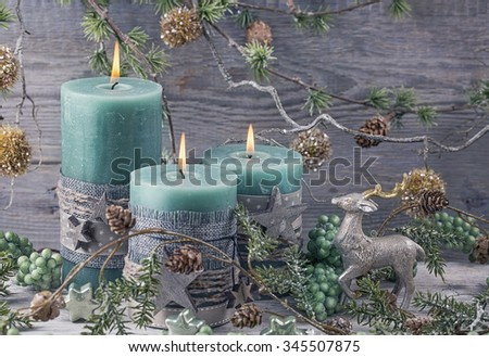 Green christmas candles and decoration - stock photo