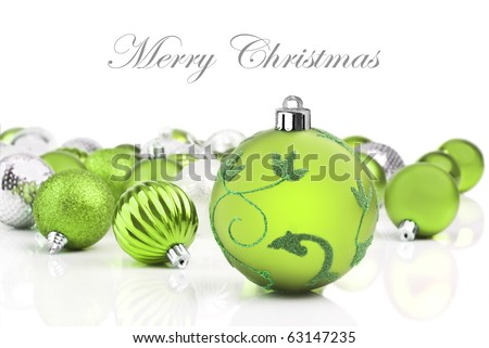 Green christmas decorations on a white background with space for text - stock photo