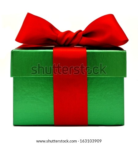 Green Christmas gift box with red bow isolated on white - stock photo