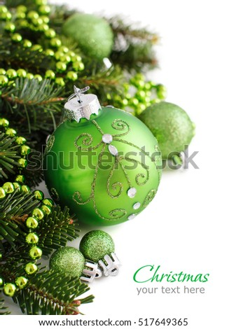 Green Christmas ornaments border on white background