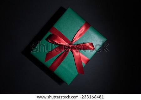 green christmas presen on black background - stock photo