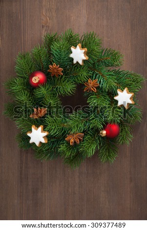 Green Christmas wreath with cookies and decorations, top view, vertical, close-up - stock photo