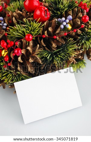 green christmas wreath with decorations isolated on white background with blanck card