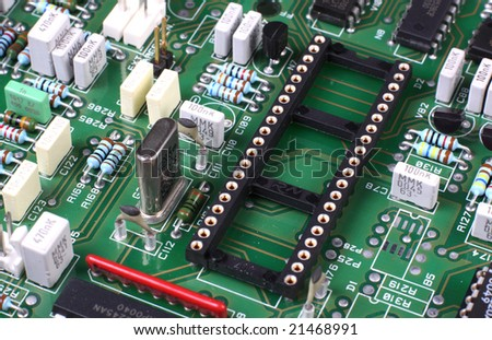 Green circuit board with components