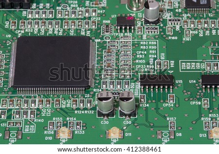 Green  circuit board with different electronic components. Computer and networking communication technology concept. - stock photo