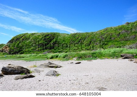 https://thumb7.shutterstock.com/display_pic_with_logo/167494286/648105004/stock-photo-green-cliffs-and-sky-648105004.jpg