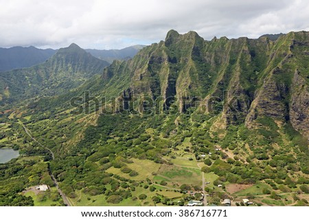 Green cliffs of Kualoa Ranch - view from helicopter - Oahu, Hawaii - stock photo