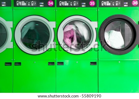 green clothes washers in a laundrette - stock photo