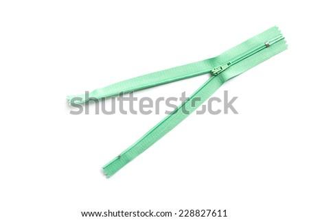 Green clothing zipper isolated on white background - stock photo