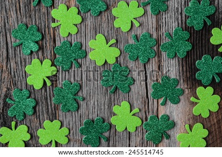 Green Clovers or Shamrocks  on Rustic Wood Background Background for St. Patrick's Day Holiday - stock photo